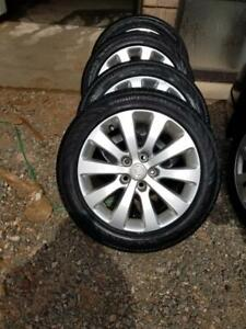 BUICK VERANO FACTORY 17 INCH WHEELS WITH CONTINENTAL 225 / 50 / 17 ALL SEASON TIRES.