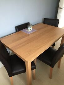Oak effect dining table and four faux leather brown chairs