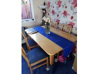 Pristine natural wood coloured dining table + 4 blue padded chairs