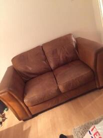 Selling 2, 2 seater sofas Tan leather
