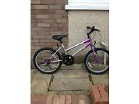 Child's Universal bike in good condition age 7+