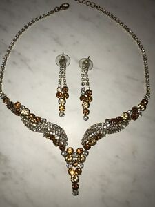 Gold and yellow stones necklace and earrings