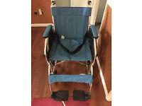 Self propelling wheelchair