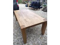 Solid oak dining table and 6 black leather chairs