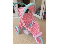 Child's pushchair for dolls.