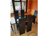 Harvey's dining glass table with 6 chairs