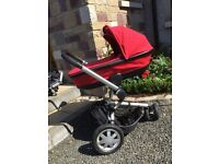 Quinny Buzz complete with isofix car seat and carrycot in red