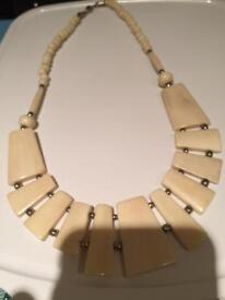 Ivory colour ladies necklace ,