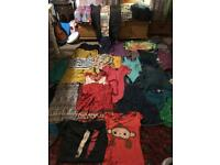 Big bundle of colourful women's clothes, some used, some new, floral and bright! Want all gone!