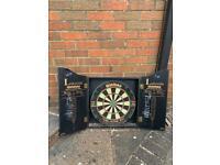 Winmau dart board and surrounding