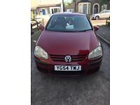 A very beautiful red golf for sale. Sensible offers accepted .