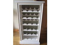 Solid wood wine rack. Holds 24 bottles