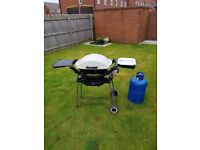 Weber gas BBQ Q200 series RRP £300used but in good condition with regulator and 15kg gas bottle