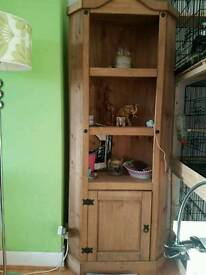 Tall wooden corner unit.
