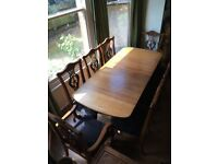 Rosewood Hepplewhite style 8 seater table and 8 chairs