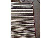 A high quality multi-coloured rug,