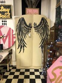 Vintage Wardrobe With Angel Tattoo Wings