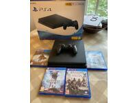 PS4 console with controller and 4 games
