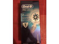 2 Oral-B Pro 2000 Electronic Toothbrush Blue and Pink