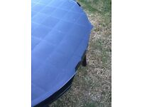 Free green plastic garden dining table (cosmetic damage see pic)