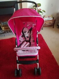 Childs Buggy pink in colour superb condition as new.