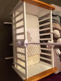 Swinging crib, bedding, bumpers and mobile.