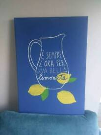 Blue canvas mounted wall art.