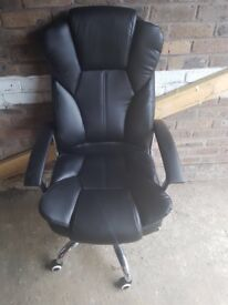 Comfy Leather black chair on wheels