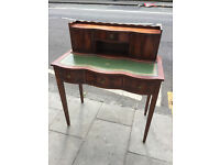 Ladies french style desk with green leather top. In good condition. Free local delivery.