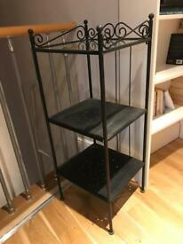3 Ikea units with glass and metal shelves. Great for more storage in a bedroom.