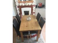 Table and 4 brown faux leather chairs