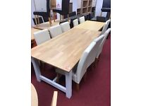 Big Dining Table and 6 Cream Skirted Leather Chairs
