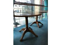 Two matching round tables