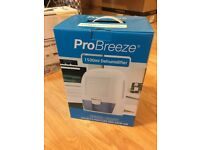 Brand New never unboxed dehumidifier compact RRP £65
