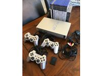 PS2 Silver, 3 controllers, 8mb memory card & many games