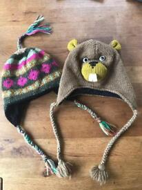 2 warm fleece lined knitted Nepal hats with earflaps
