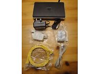 Four boxed D-Link DSL-2640R Broadband Wireless ADSL2+ Routers plus five random telephone filters.