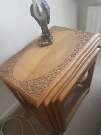 Nest of carved side tables