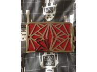 Small silver and red clutch bag Leko London