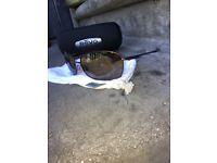 Revo Eyewear Sunglasses Rotate RE9016-01 Copper Brown Frame Polarized Bronze.