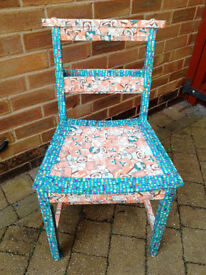 Up-cycled blue and orange multi-colour decopatch chair.