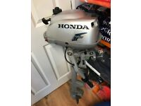Honda 2.3hp Four Stroke short shaft outboard engine.
