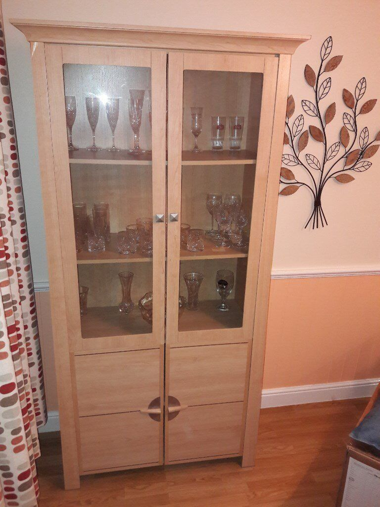 Display cabinet with glass doors and separate lower compartment with integral shelf