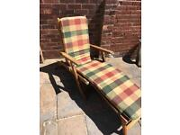 Wooden sunlounger with cushion