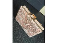 Peach coloured Clutch handbag