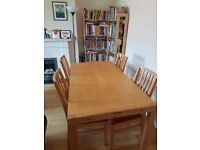 Dining table solid wood and extendable with four chairs