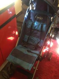 Push chair hardly used with rain cover