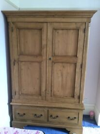 Solid wood double door wardrobe with detailing
