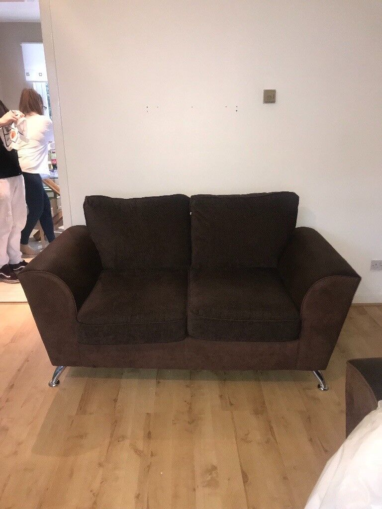 Two 2 seater sofas & one swivel chair with cushions