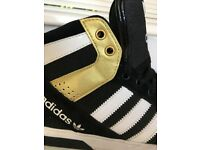 Adidas Womens High Tops UK 6.5 Black & Gold. Used. Still in good condition.